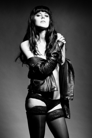 Black and white photography - model topless with leather jacket
