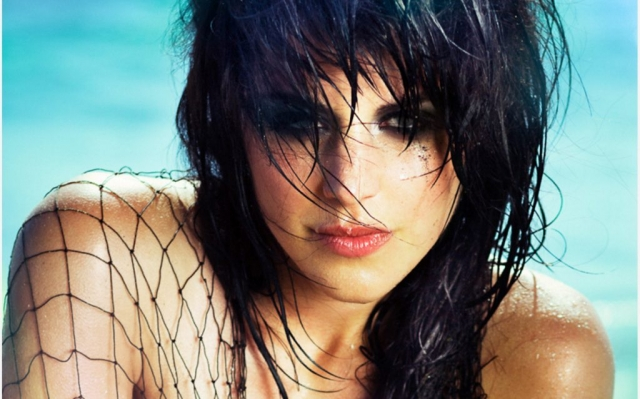 Close-up model with wet hair on beach