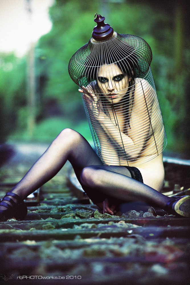 Model kept in a cage
