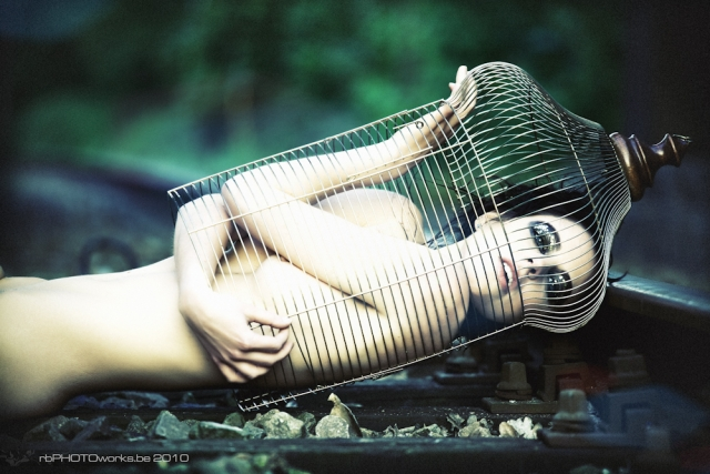Model kept in a cage on railway